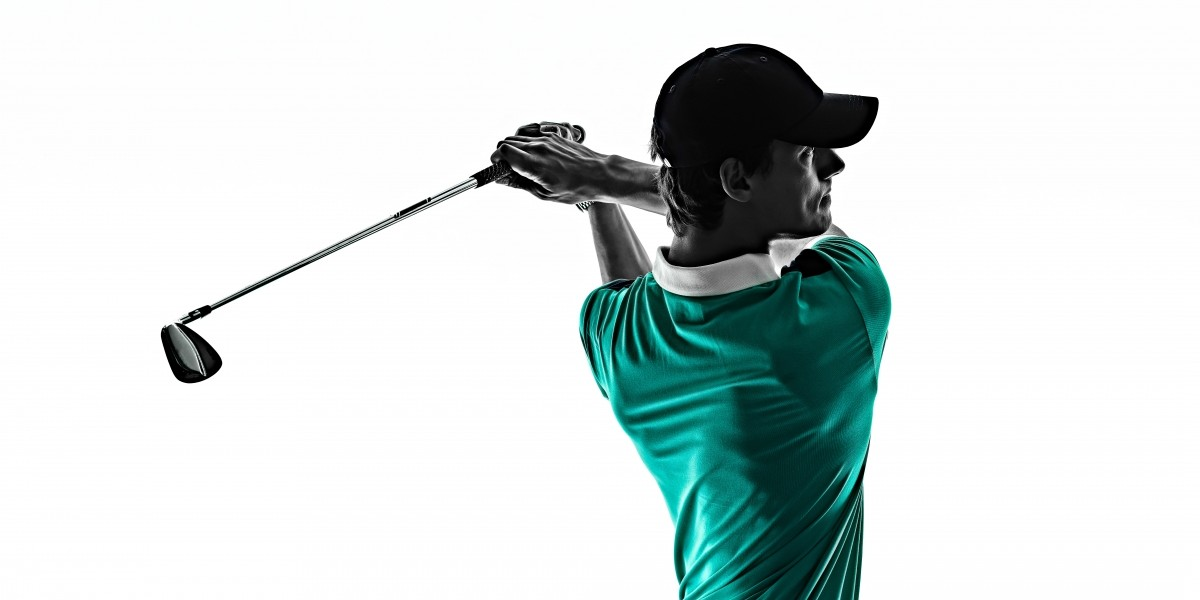 Professional photo of man in golf followthrough