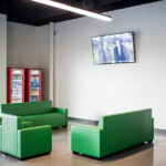 Image of green couches at X-Golf