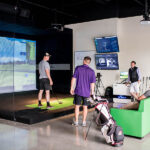 Image of a group of guys conversing at X-Golf