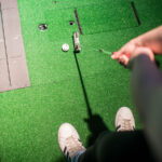 Top-down image of person about to putt