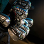 Image of numerous irons in an X-Golf bag