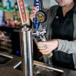 Image of bartender pouring tap beer at X-Golf Fort Collins