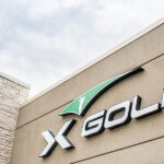 Large X-Golf logo on side of building
