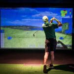 Image of man watching his shot tracer at X-Golf