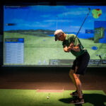 Image of man during downswing at X-Golf