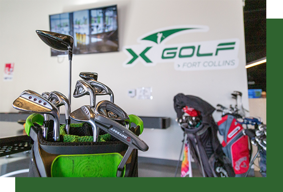 Image of golf club bags in front of X-Golf logo